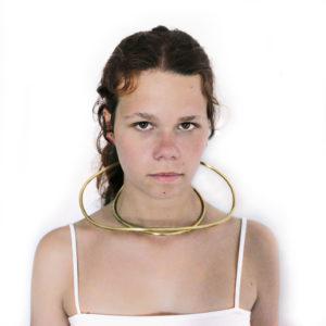 Bold , minimalist and dramatic Neck jewellery weared by Aurélia for the brand Nicchia Jewellery.